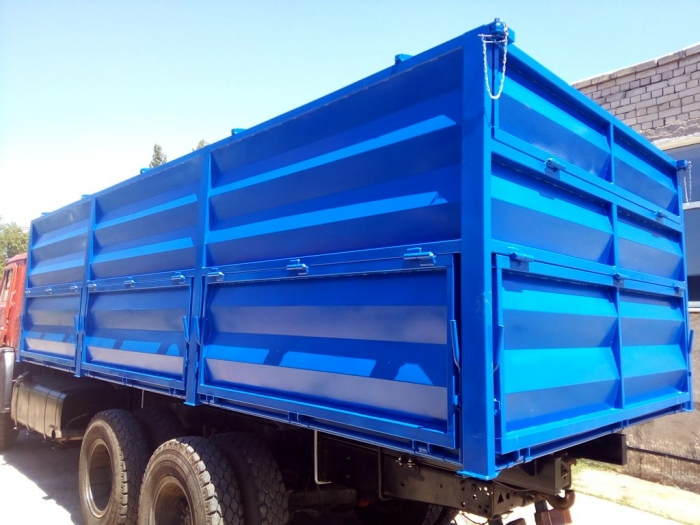 Metal indoor tipper body (container-grain) under the vehicle's chassis KAMAZ for transportation of grain products and other bulk products